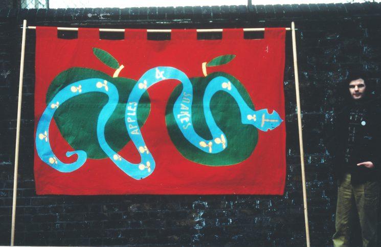 Zolan Quobble standing beside Apples and Snakes banner   Emile Sercombe/Berni Cunnane